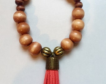 Light brown wooden beads with tassel