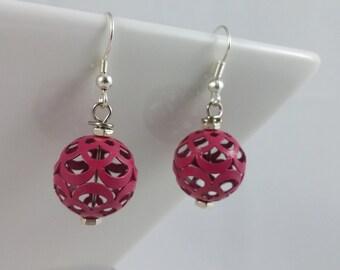 Fuchsia metal bead hook earrings.