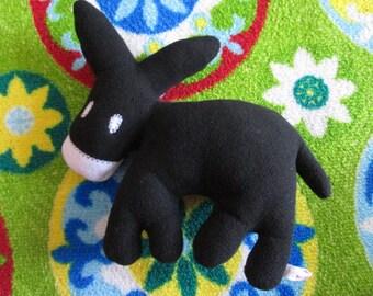 Plush black donkey
