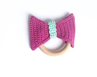Colorful bow on woorden teether