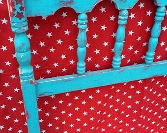 Whimsical with stars. Distressed, twin headboard in aqua and real red!