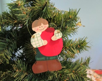 boy holding bulb ornament