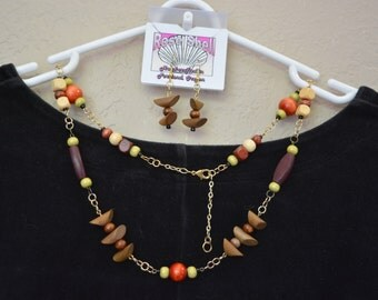 Wood beads and chain necklace with wood bead earrings.