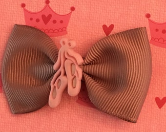 Ballet slipper charms on bows