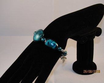 a Beautiful Statement blue lamp work plus silver plate charm bracelet