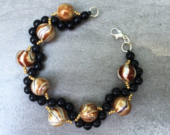 Black and swirly gold pearls bracelet, boho, dramatic, gift for her, formal, bold, everyday wear, fantasy beads