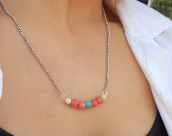 Gorgeous necklace with peach stone beads and a statement turquoise bead