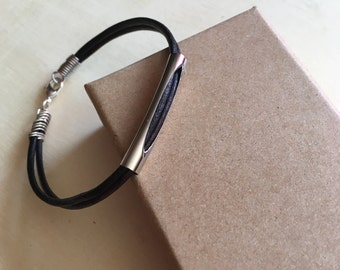 Faded black string noodle silver bracelet