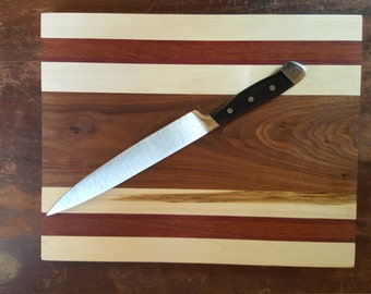Maple, Black Walnut, Purple Heart, and Lacewood Cutting board.