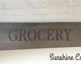 Reclaimed wooden grocery sign