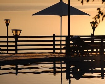 Sunset Sea View – Sunset Seascape Travel Photograph Featuring Infinity Swimming Pool And Pool Furniture, Brown And Ochre