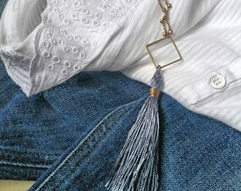 Golden necklace and pendant with black tassel-embellished Boho chic