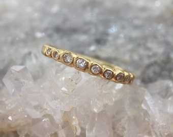 Fair trade gold and diamond half eternity ring
