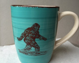 Sasquatch Turquoise Blue and Cream Colored Ceramic Coffee Cup