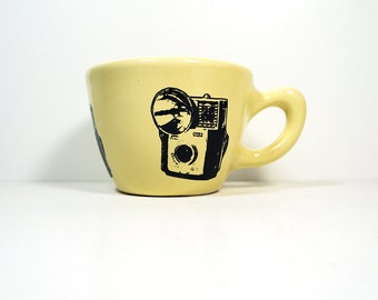 12oz cup with a Starmite camera print on it, shown here on buttercream glaze - Made to Order / Pick Your Colour