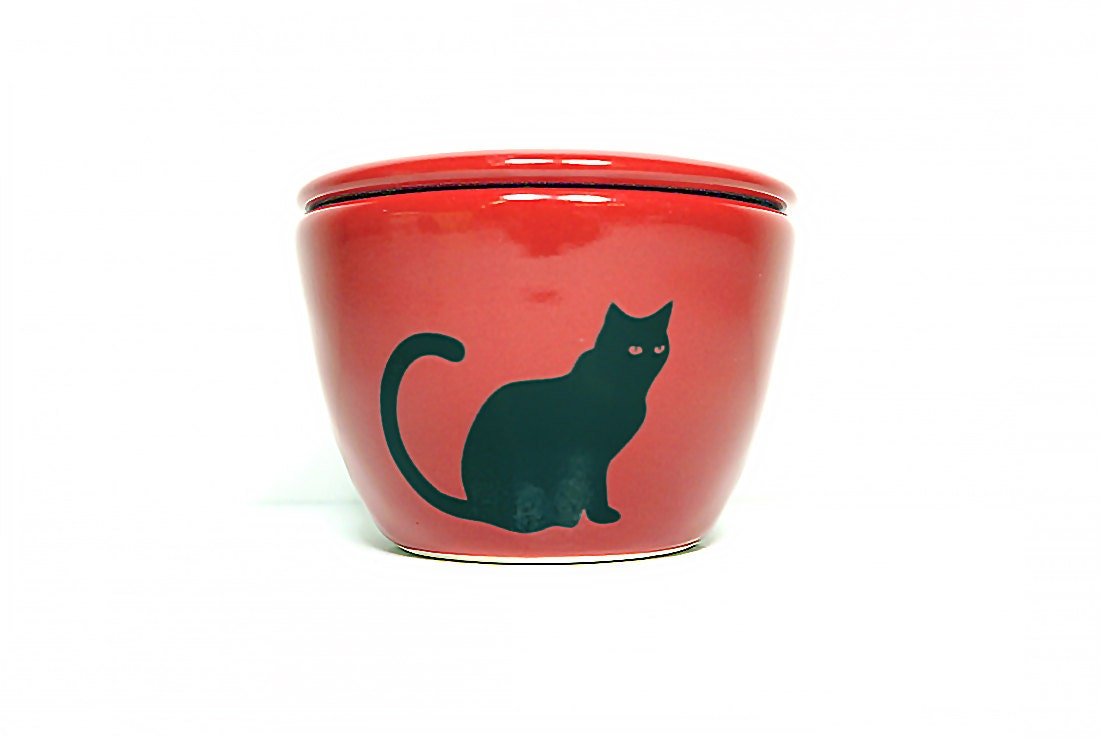 a lidded bowl / jar with a Black Cat silhouette print shown here on a Berry Red glaze, Made to Order / Pick Your Colour / Pick Your Print