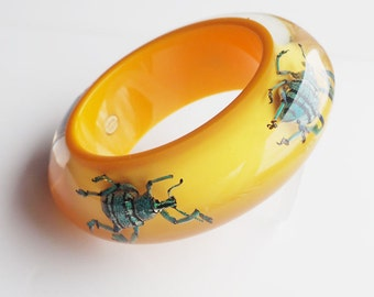Yellow lucite bracelet with real exotic beetles