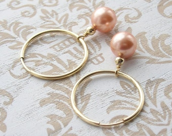 Gold hoops with peach pearl drops
