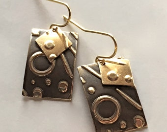 Hand Embossed BrassTextured Earrings with Charm...