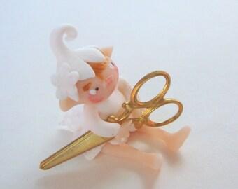 Tiny fairy with scissors