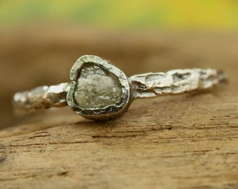 Engagement ring rough diamond in bezel setting with hard texture oxidized sterling silver band
