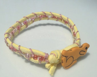 button bracelet yellow dog