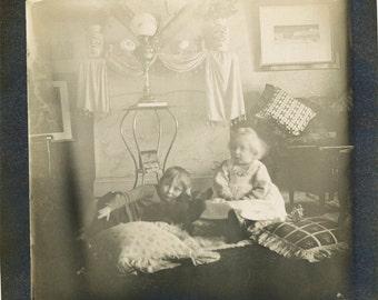 vintage photo 1907 Victorian Children in Parlor Pillows Kitten Lamp Interior