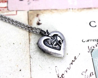 carousel horse. locket necklace. in silver ox jewelry heart