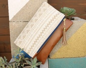 Boho Tassel Clutch in Cream Tribal Ikat Print with Tan Vegan Leather and Navy Blue and Gold zipper close