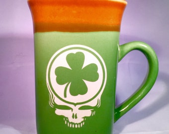 Grateful Dead Etched Coffee or Tea Mug featuring a Steal Your Face Irish Lucky 4 leaf Clover