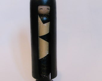 Tall kokeshi with hair