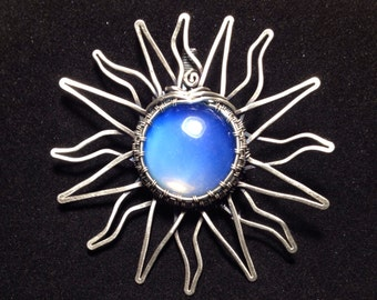 Hold for Louise // Hand hammered and woven Sea Opal Glass Sun pendant