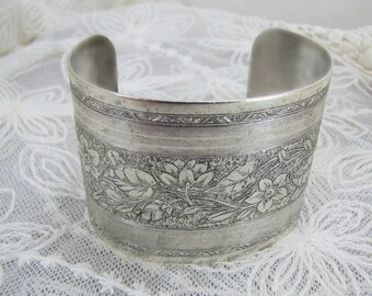 Embossed Wide Silver Cuff With Floral Design