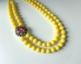 Statement yellow necklace double strand fabric jewel