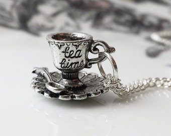 Alice in wonderland necklace ..It's always TEA time darling little teacup necklace