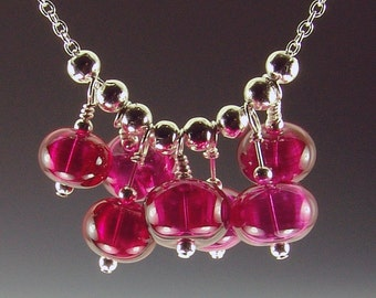 Cherries Jubliee-Hollow Lampwork Bead necklace, 7 beads on 18 inch silver plated chain