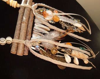Rustic Bohemian Necklace, Cowrie Shells, Stick MOP, Cow Bone, Wood Sticks, Tiki Face, Coins, Wire Wrapped Agate Spear, Bell, Leather, Ribbon