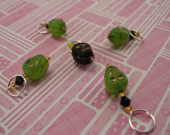 Green and black skull stitch markers