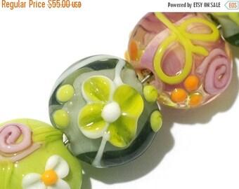 ON SALE 50% OFF Glass Lampwork Bead Set - Seven Pink/Orange/Green Lentil Beads 11001702