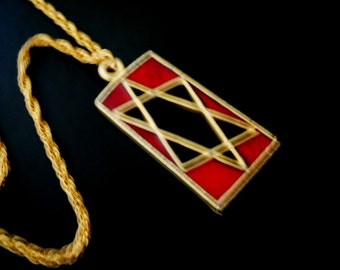Judaica vintage 70s gold tone metal necklace with  red enamel pendant and cutouts star of the David.