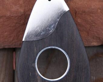 wood and silver tone metal guitar pendant