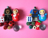 Capsule Red / Blue Babies - assorted toy set