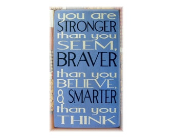 You are stronger than you seem braver than you believe wood subway typography sign