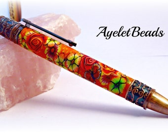 A beautiful, one of a kind handcrafted polymer clay pen.