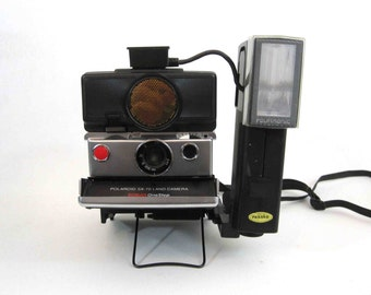 Vintage Polaroid SX-70 Sonar Folding Land Camera with Flash Unit. Circa 1970's.