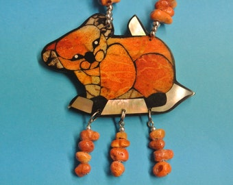 Rare handcrafted vintage 1970s natural organic apple blossom coral koala bear pendant necklace in design by Lee Sands