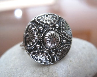 Detailed Button Engraved Ring with adjustable back.
