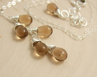 Necklace with a Cascade of Brown Glass Teardrops on a Sterling Silver Chain CDN-604