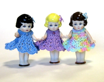 "Frozen Charlottes 3"" doll  cast in porcelain  from a vintage mold and dressed in  crocheted dresses"