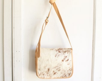 vintage cowhide leather crossbody bag 90s | hair on hide saddle bag